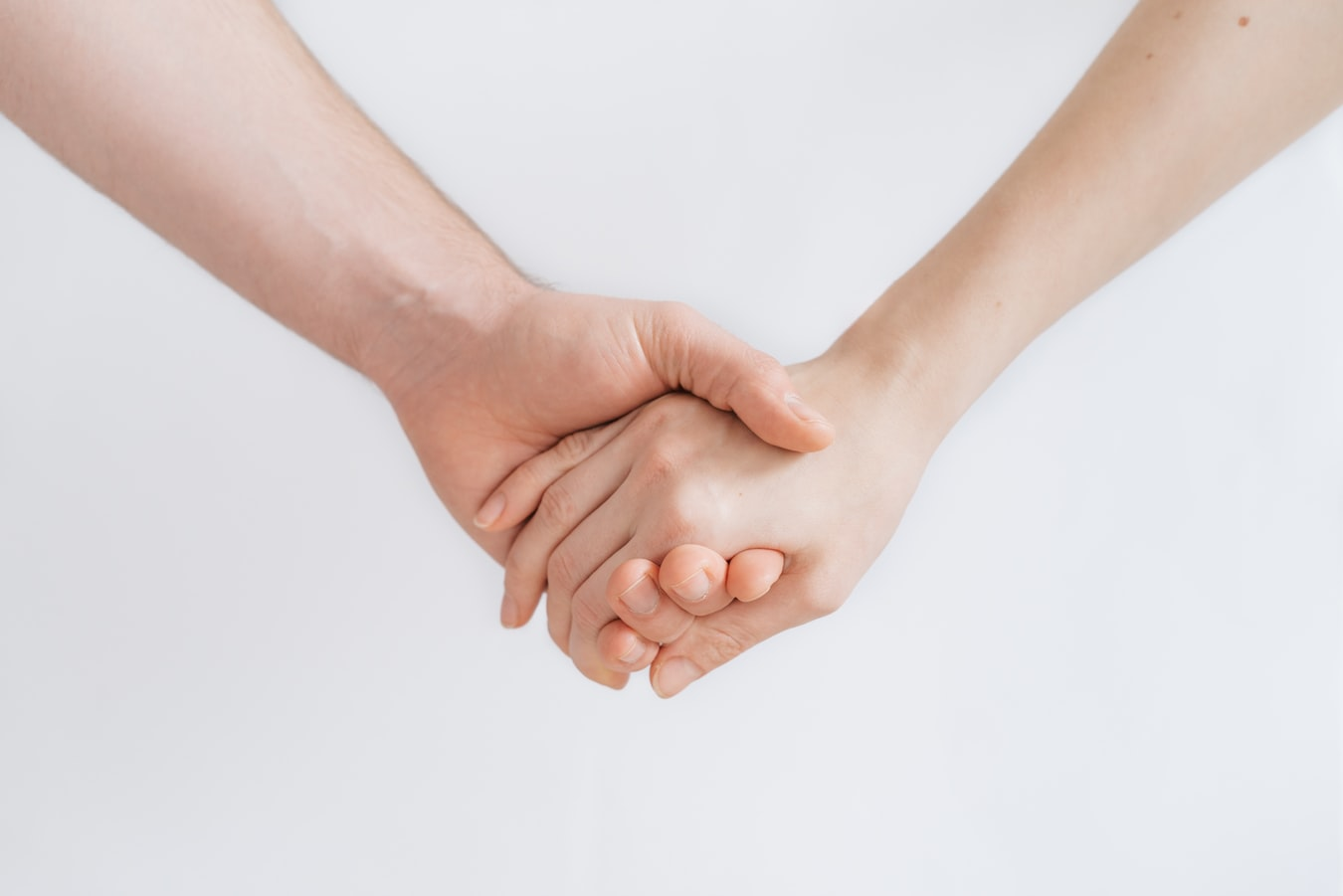 Two hands coming together