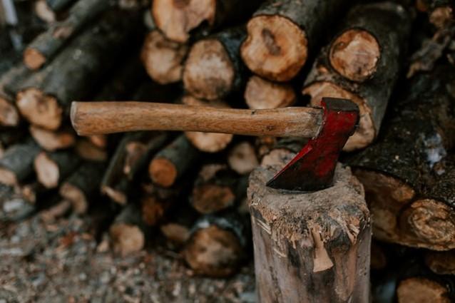 Axe on wood chopping block