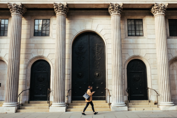 Person walking past Bank of England building